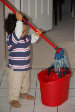 Toddler with mop