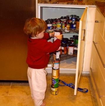 autistic toddler stacking cans